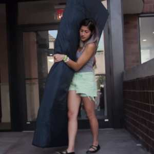 Sulkowicz with her mattress (via http://nymag.com/daily/intelligencer/2014/09/columbia-student-art-project-protests-her-rapist.html).